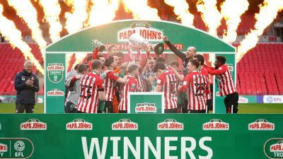 Sunderland players celebrate with the Papa John's Trophy after the 2021 final at Wembley Stadium, London