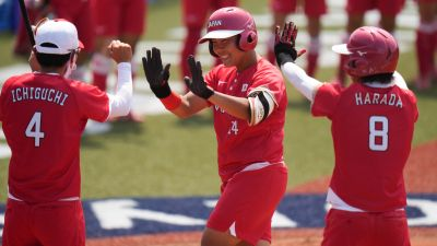 Japan's Minori Naito, center, celebrates with her teammates after hitting a two run home run during the softball game between Japan and Australia at the 2020 Summer Olympics,