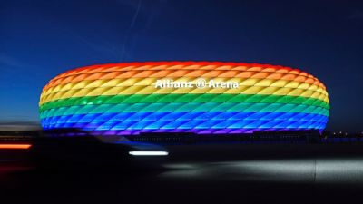 Munich's stadium is illuminated in rainbow colors on the occasion of Christopher Street Day in Munich, Germany, Saturday, July 9, 2016. UEFA has declined the Munich city council's application to have its stadium illuminated in rainbow colors for Germany's final Euro 2020 group game against Hungary on Wednesday June 23, 2021. (Tobias Hase/dpa via AP)