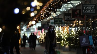 People walking through a shopping centre decorated with Christmas lights in London, in the final week of a four week national lockdown to curb the spread of coronavirus.