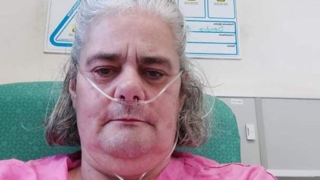 18-10-21 Sandra in hospital with breathing apparatus connected-Family picture