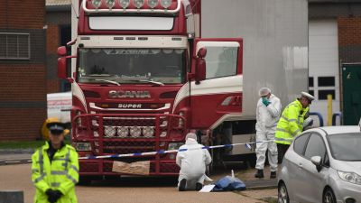 File photo dated 23/10/19 of police and forensic officers at the Waterglade Industrial Park in Grays, Essex, after 39 bodies of Vietnamese migrants were found inside the lorry on the industrial estate. Four men are due to go on trial this week for their alleged part in a people-smuggling plot linked to the deaths of 39 migrants.