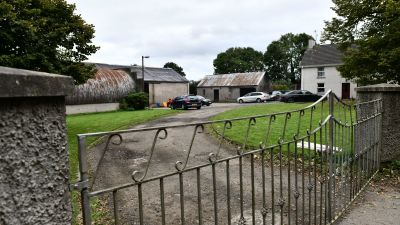 A murder investigation was launched after a woman was found in a burning car in  Co Londonderry.