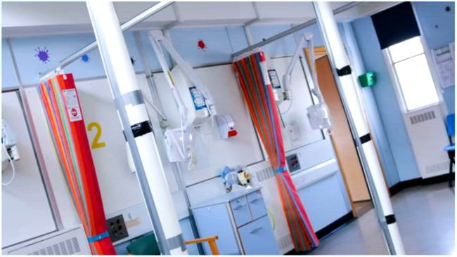 Interior shot of the Queen Elizabeth Hospital in King's Lynn with some of the metal struts holding the ceiling up