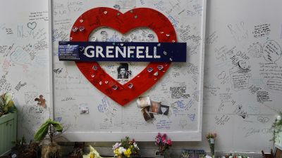 Messages are written on a construction wall near Grenfell Tower in London, Wednesday, Oct. 30, 2019.