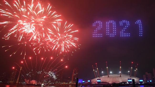 Fireworks and drones illuminate the night sky over The O2 in London
