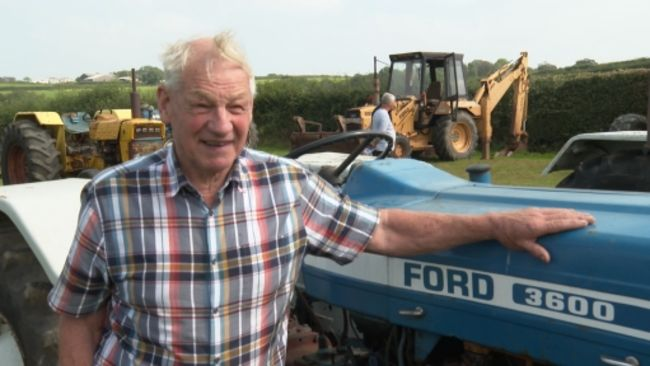 Philip has been collecting three types of blue and white Ford tractors for 32 years
