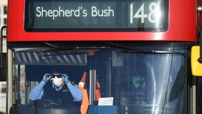 A London bus driver adjusts his sunglasses on Westminster Bridge, London, after Prime Minister Boris Johnson made the decision to put the UK in lockdown to help curb the spread of the coronavirus.