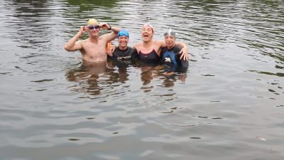 Jacquie Hughes (second right) celebrating her son Tom Dean's second gold