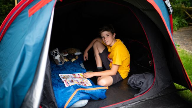 Max in his tent
