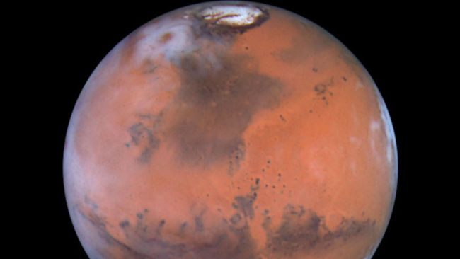 Photo of Mars, as seen by the Hubble Space Telescope. A close encounter of the Martian kind was due to occur Wednesday June 13 2001, and could trigger a flood of UFO reports. Mars was heading towards its closest approach to Earth in more than a dozen years.