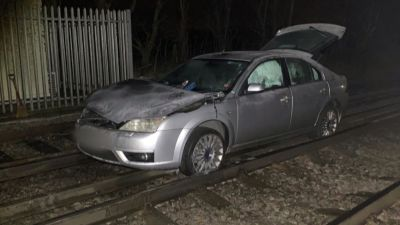 250121-abandoned car on railway in kent