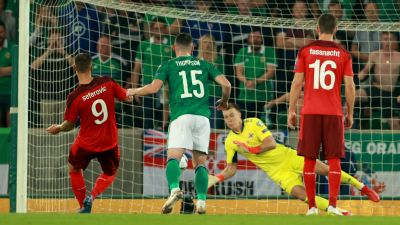 Switzerland's Haris Seferovic penalty is saved by Northern Ireland's Bailey Peacock-Farrell during the 2022 FIFA World Cup Qualifying match at Windsor Park, Belfast.  Picture date: Wednesday September 8, 2021. Picture by: Niall Carson / PA Images
