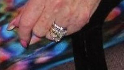 An engagement ring and a wedding ring worth a combined £13,500 which were taken from the finger of a woman who had died in hospital