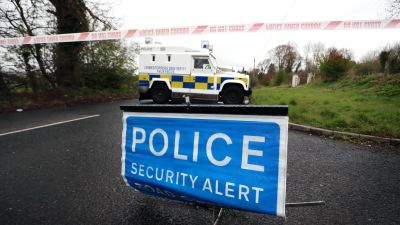 Police at the scene of a bomb alert that turned out to be a viable fireball-type device planted near a female police officer's car in Dungiven, Co Londonderry.