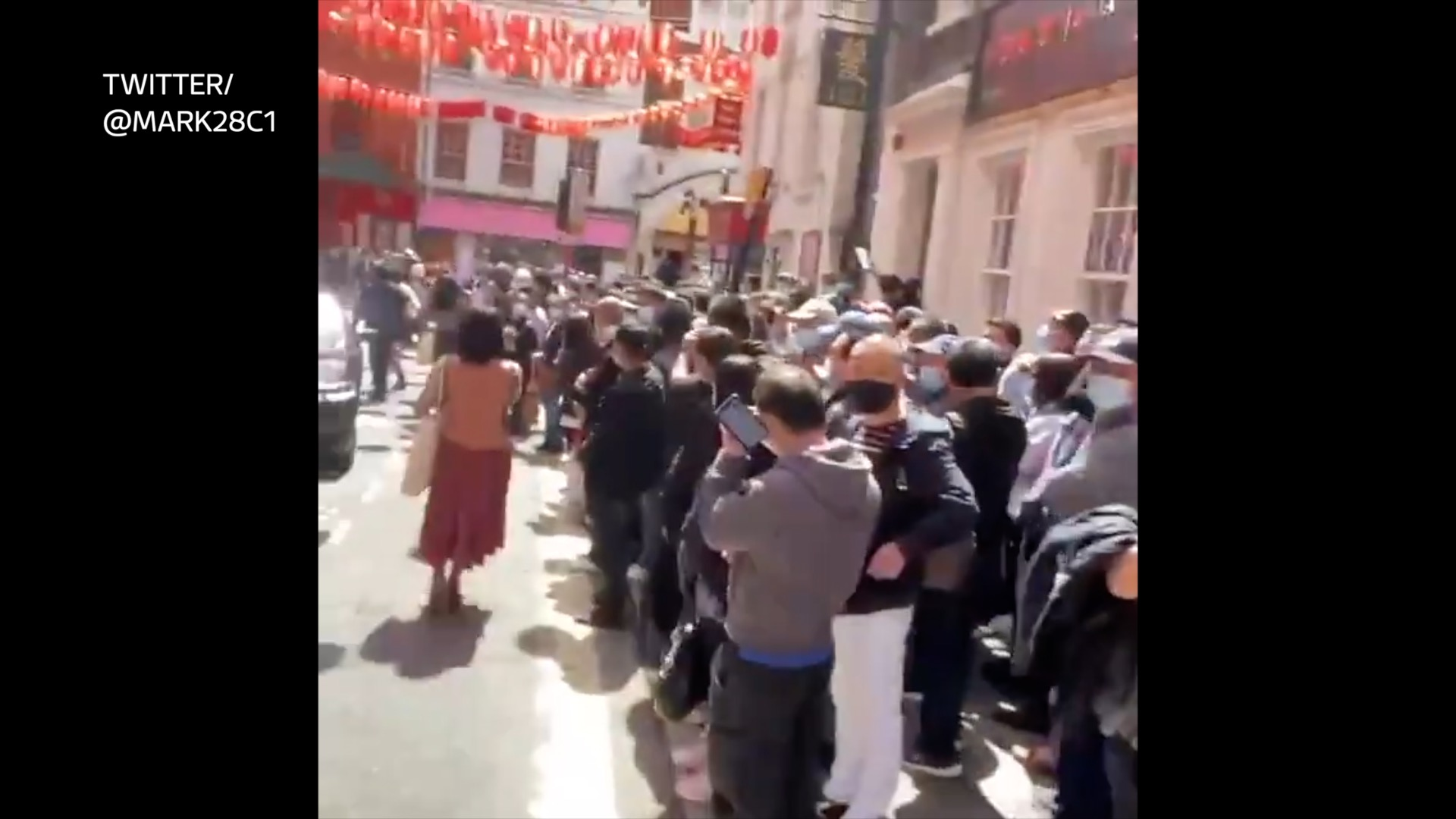 Huge crowd packs into London's Chinatown for 'no questions asked' jab