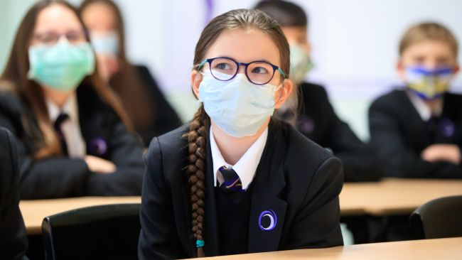 File photo dated 8/3/2021 of children wearing facemasks during a lesson at Outwood Academy in Woodlands, Doncaster in Yorkshire. Mask-wearing for pupils could return to schools under contingency plans to keep coronavirus at bay in the classroom over winter. Education Secretary Nadhim Zahawi said he did not want to see the return of bubbles, where whole classes or year groups could be sent home after a positive Covid test. Issue date: Thursday October 7, 2021. PA/Danny Lawson