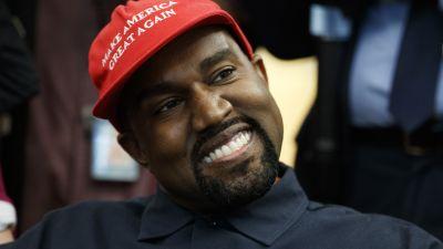 Kanye West in a Make America Great Again cap