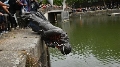 Edward Colston statue is thrown into Bristol harbour during a protest.