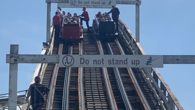 Visitors are helped down from the Grand National rollercoaster ride at Blackpool Pleasure Beach.