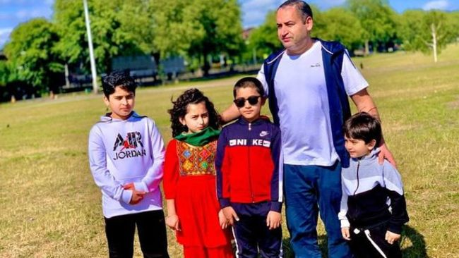 Raghib Ziahe, 48, pictured with his children. Asma, now nine, and Omar, now five.