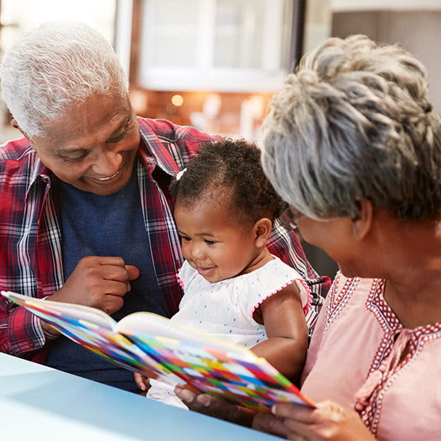 Grandparents-read-with-baby