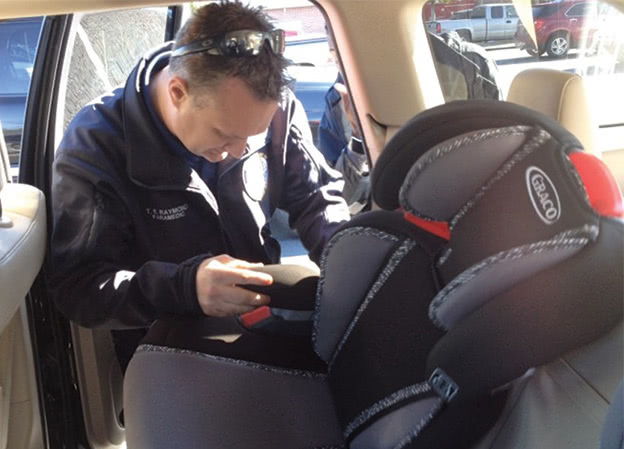 Fireman-inspects-carseat