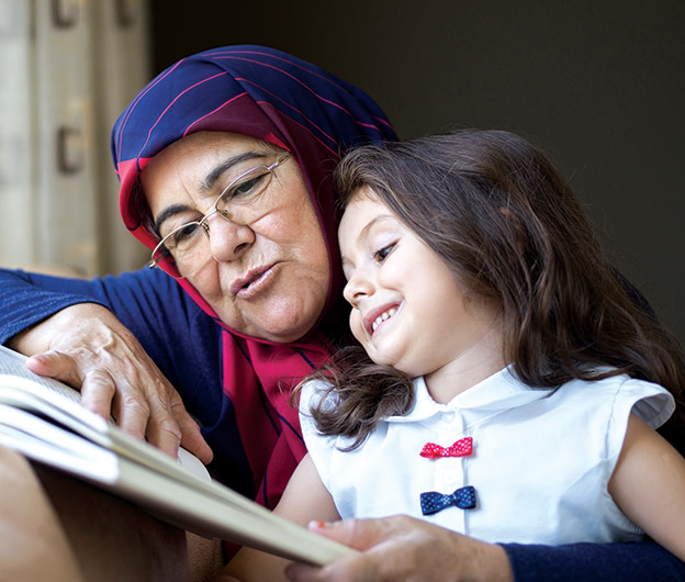 Grandmother-reads-with-girl