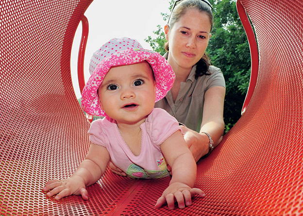 Baby-plays-on-slide