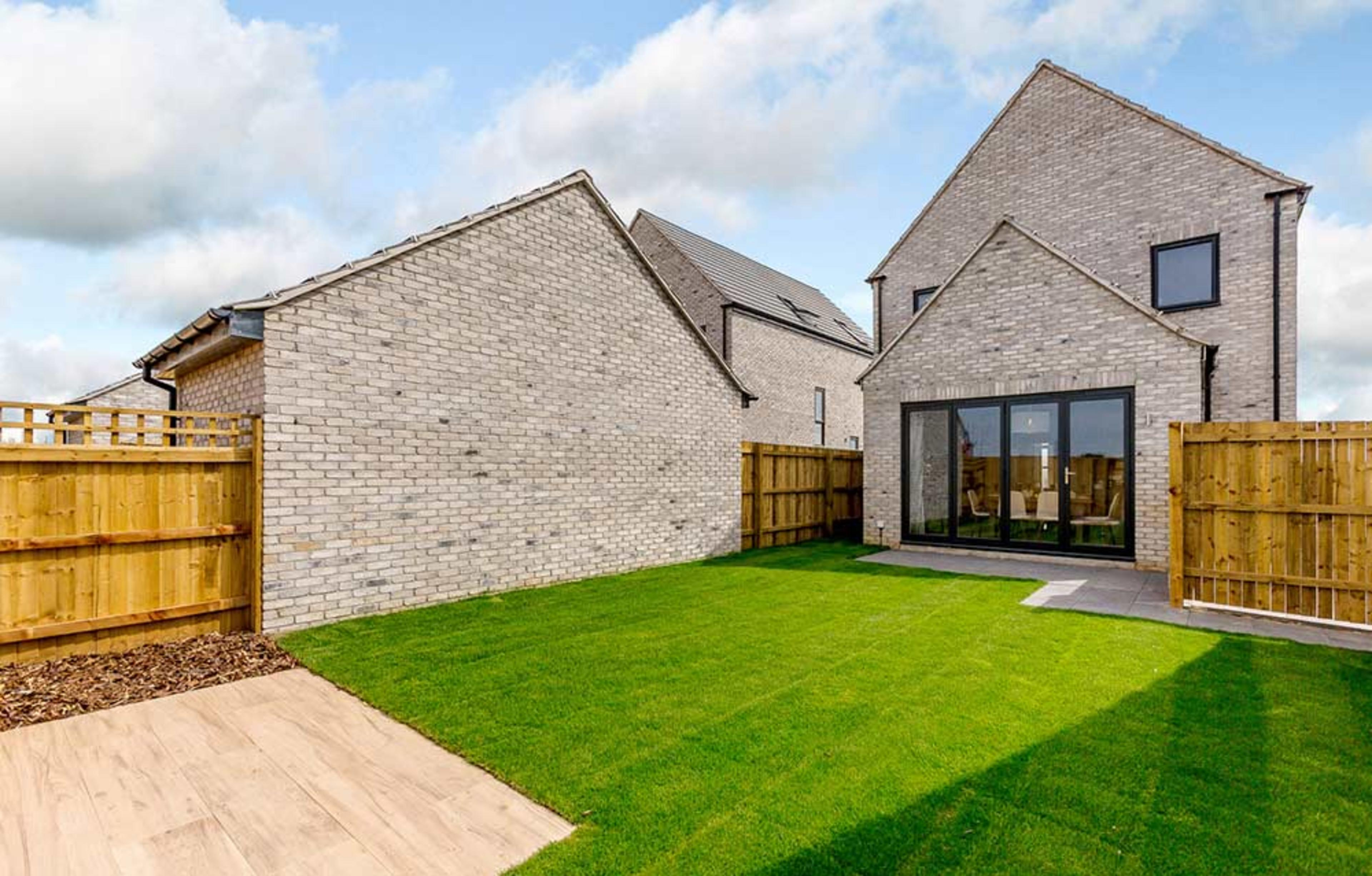 Rear garden, lawn and fencing of a new-build detached home at Meaux Rise