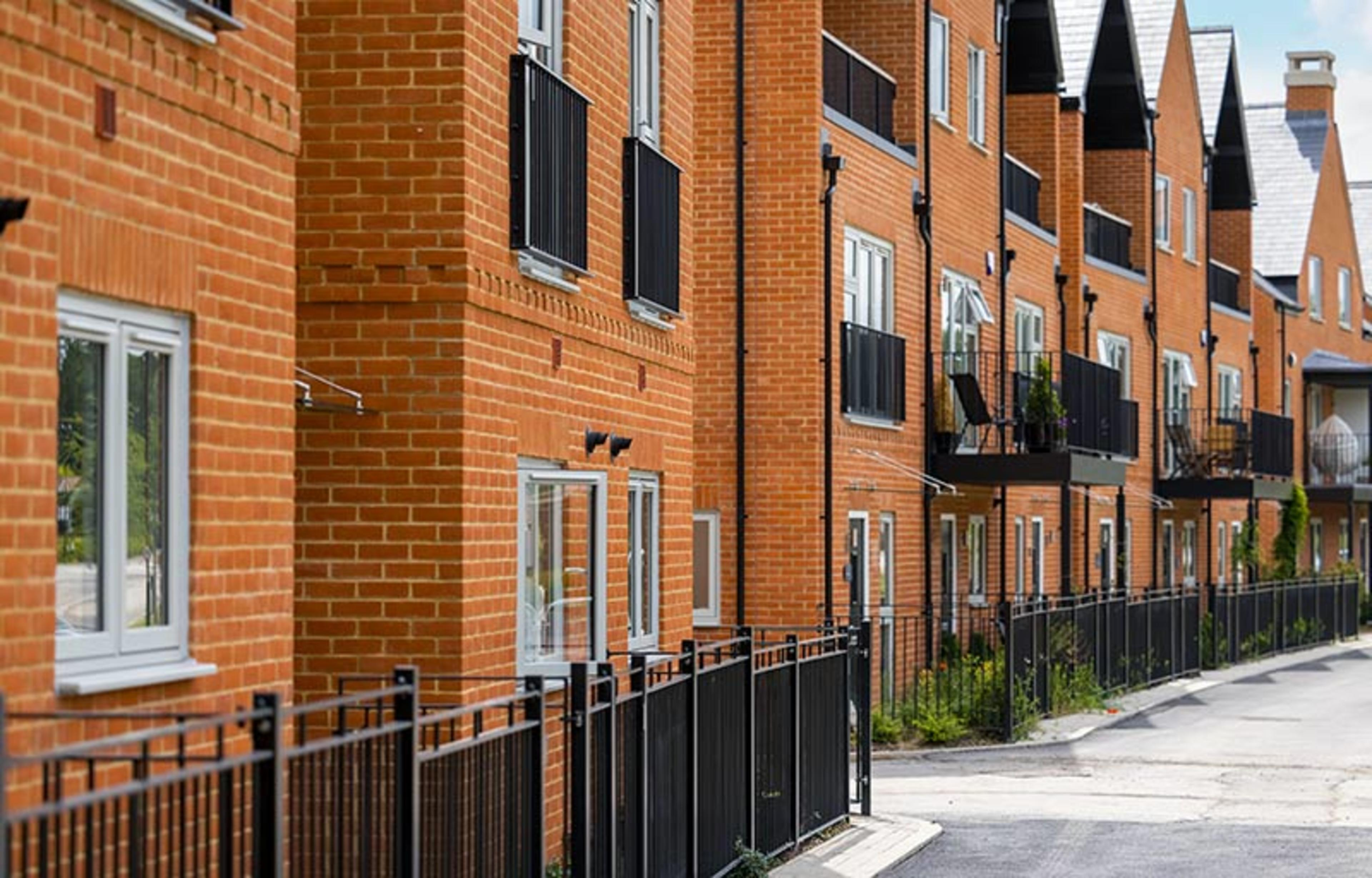 View of the rear of town houses and apartments with balconies at Kings Barton, Winchester