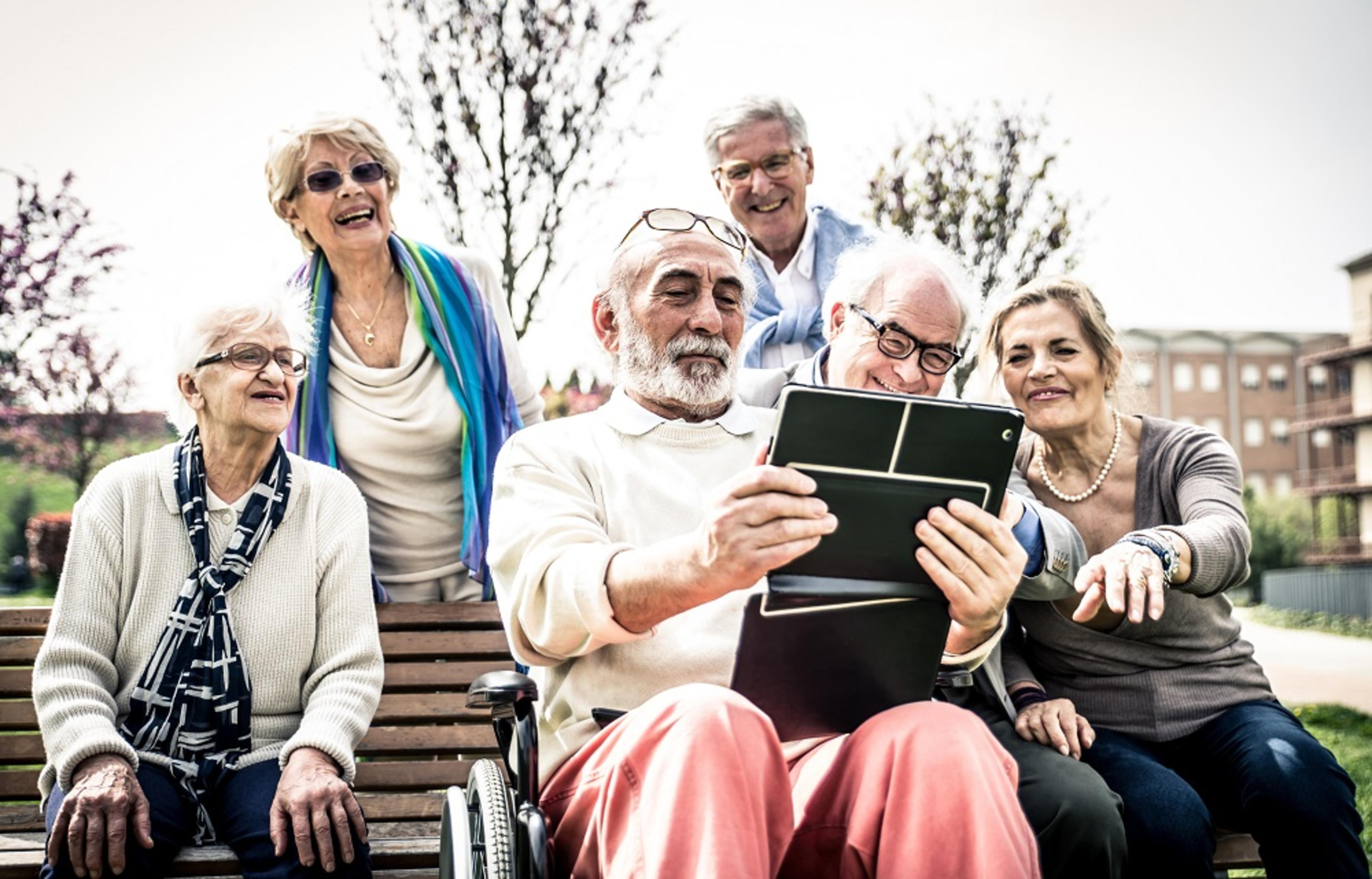 Huntley Place, Reading - group on bench with tablet