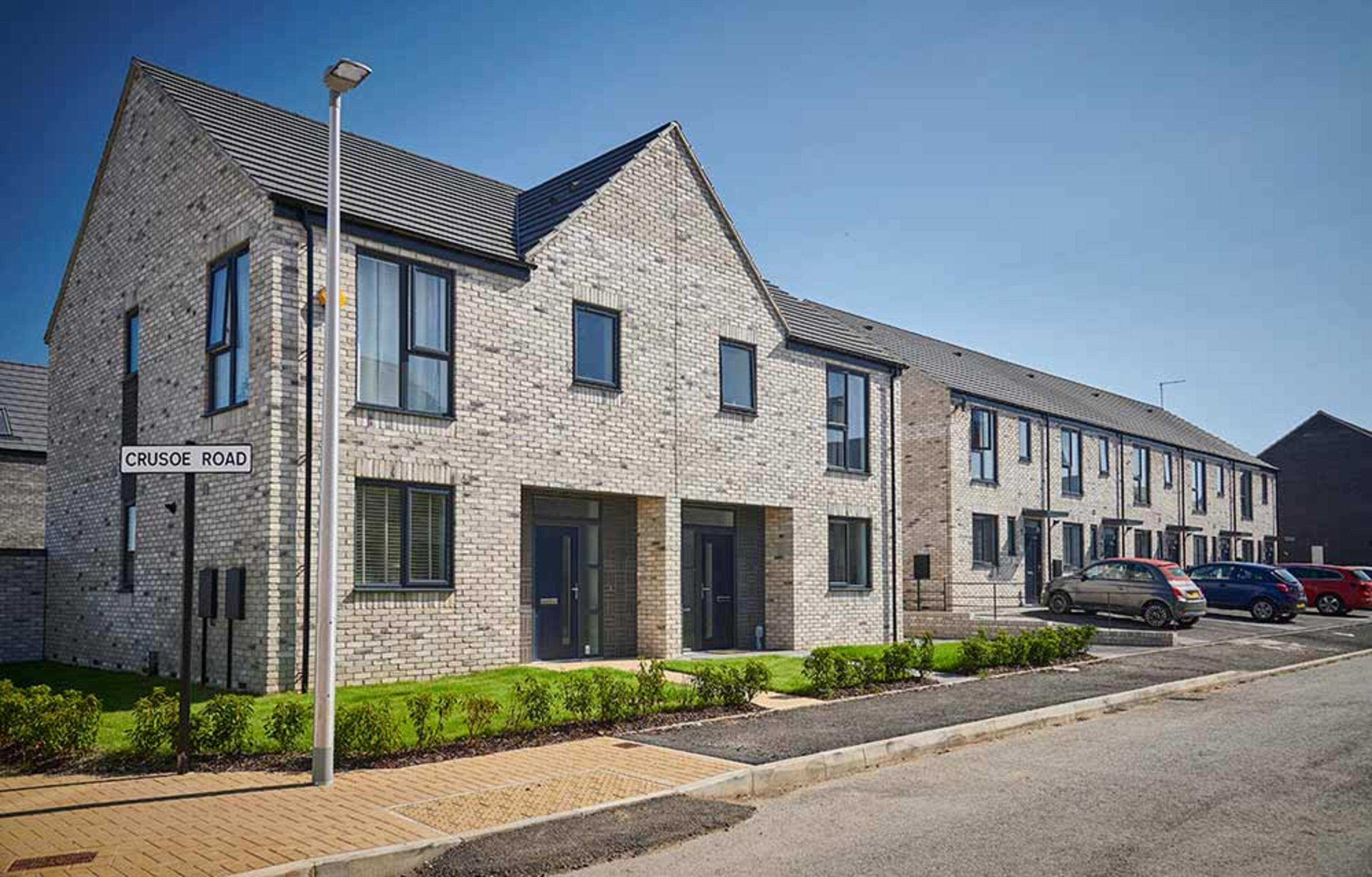 A row of semi-detached new build homes on Crusoe Road, Meaux Rise
