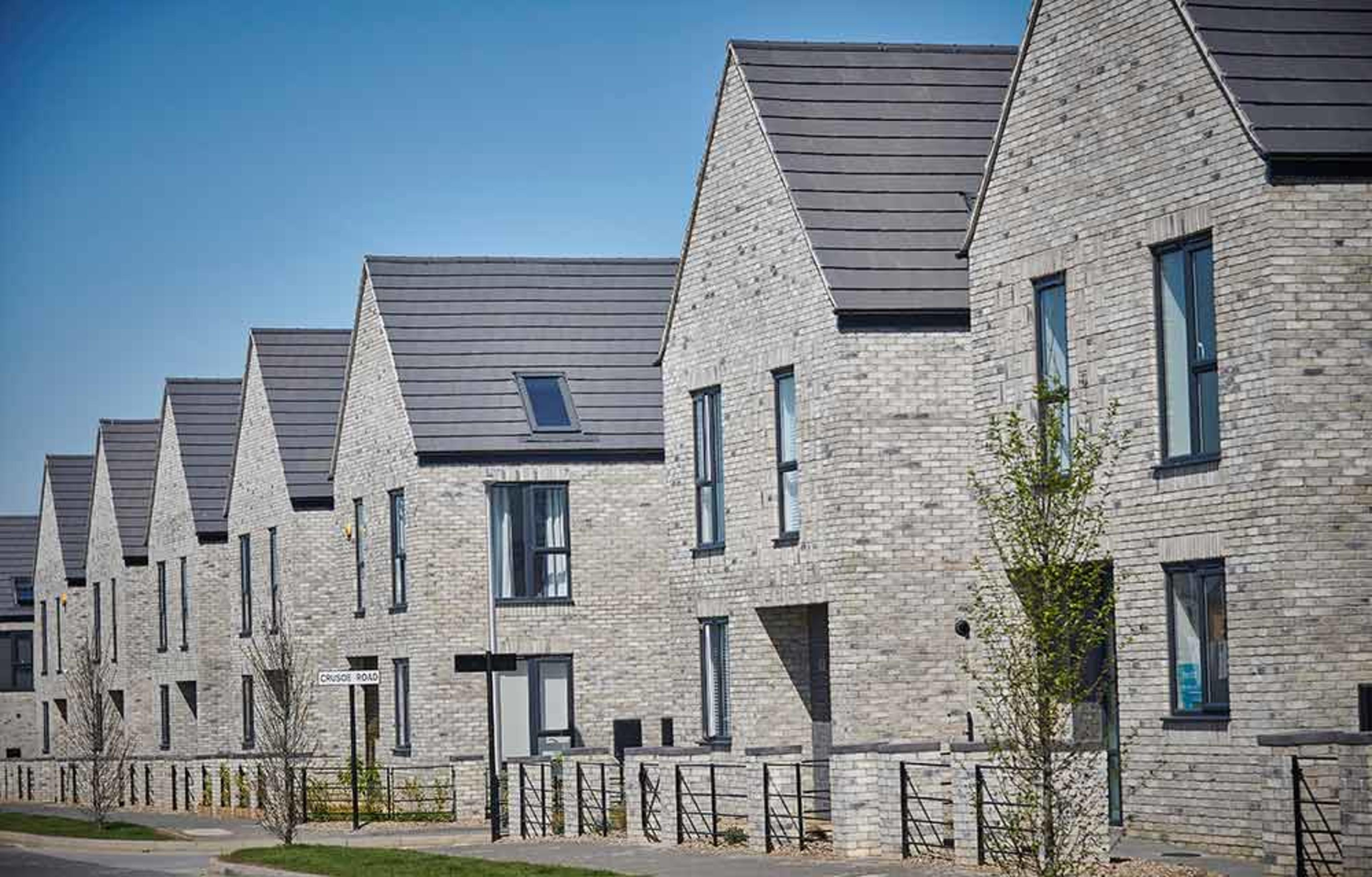 A row of new-build detached homes at the Meaux Rise development