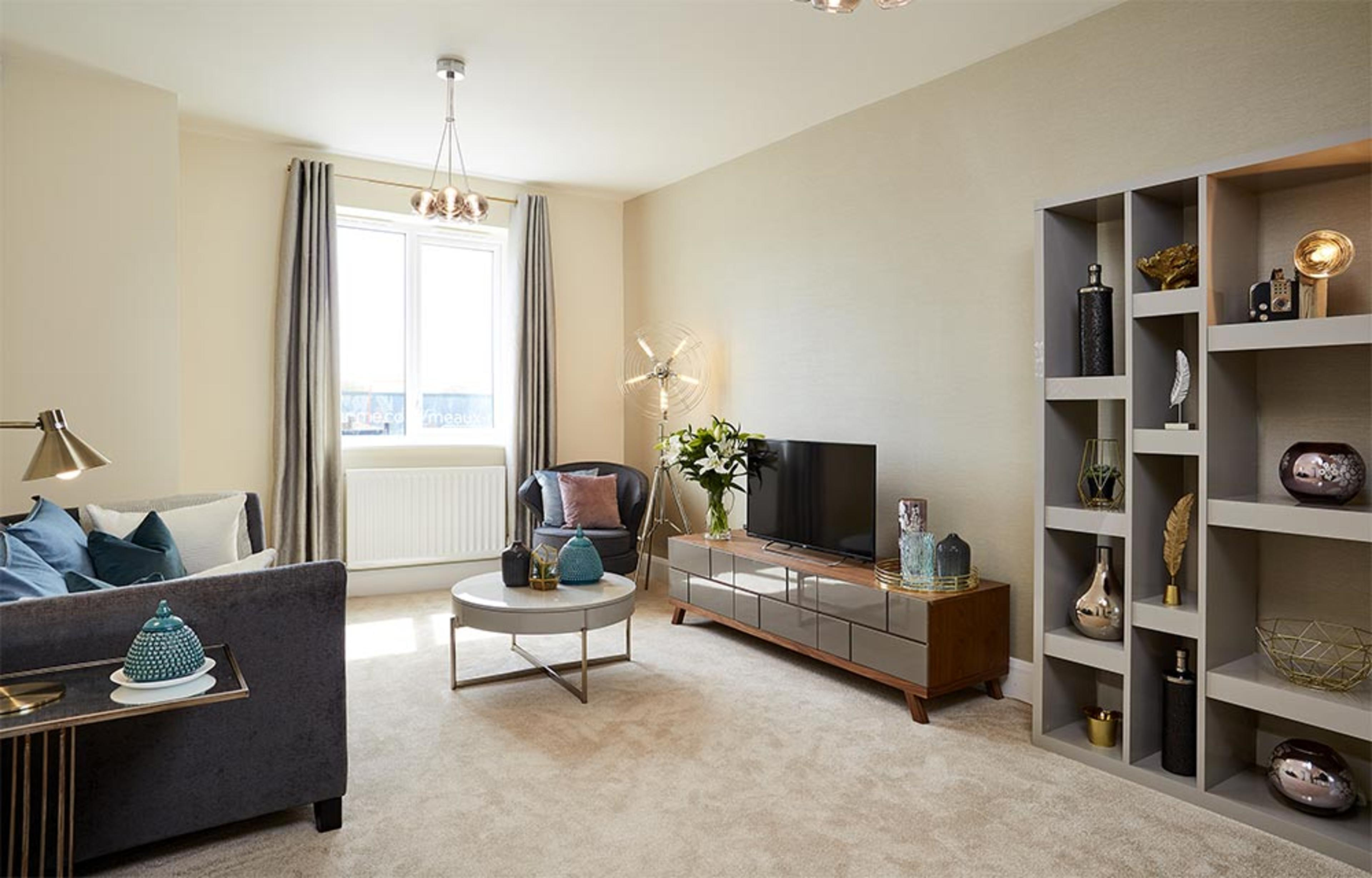 Living room with sofa and furniture in the Octave home at Meaux Rise in Kingswood, Hull