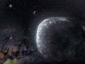 An artist's rendition of a binary object in the Kuiper belt. The two objects depicted orbit each other at the edge of the solar system.