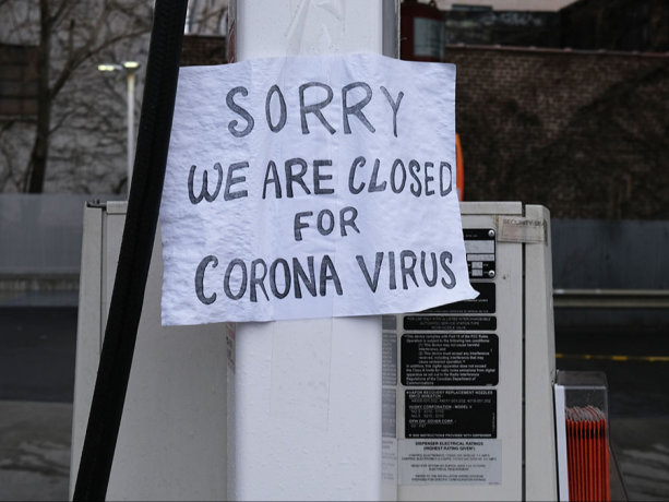Sign at a gas station alerts customers that a business in Queens, which has one of the highest infection rates of coronavirus in the nation, is closed on April 3, 2020 in New York City.