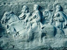 "Granite carving of Confederate leaders Jefferson Davis, Robert E. Lee, and Thomas (""Stonewall"") Jackson, Stone Mountain, Ga."