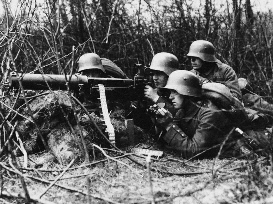 German infantrymen operating a Maxim machine gun