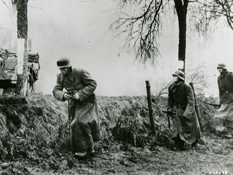 German soldiers passing American equipment at the Battle of the Bulge