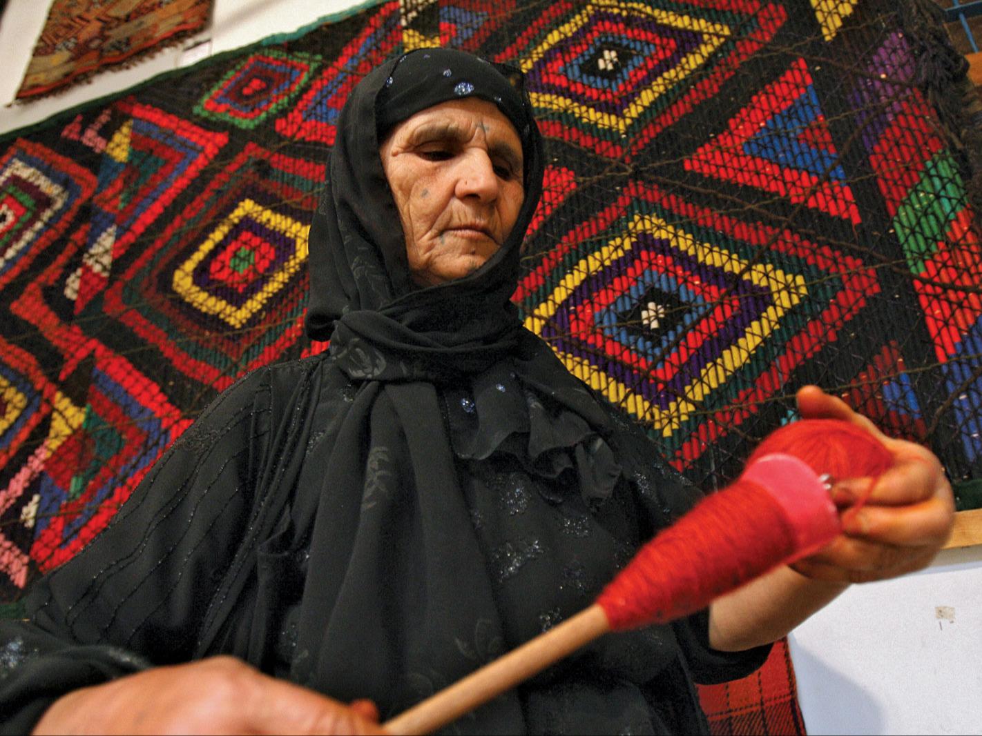 Kurdish woman winding wool.