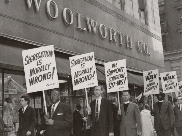 Ministers picketing a Woolworth store in New York City to protest racial segregation at the lunch counters of the chain's Southern branches, 1960.