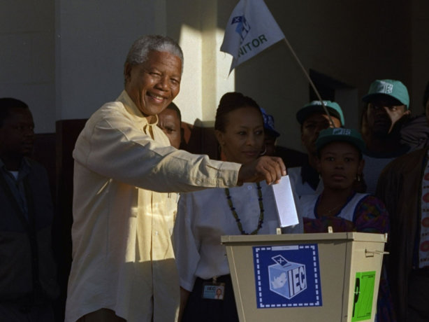 Nelson Mandela voting in South Africa's historic 1994 election, the first time in the country's history that all citizens, regardless of race or ethnicity, were allowed to vote.