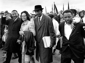Martin Luther King Jr., and his wife, Coretta, lead off the final lap to the state capitol at Montgomery, Alabama on March 25, 1965.