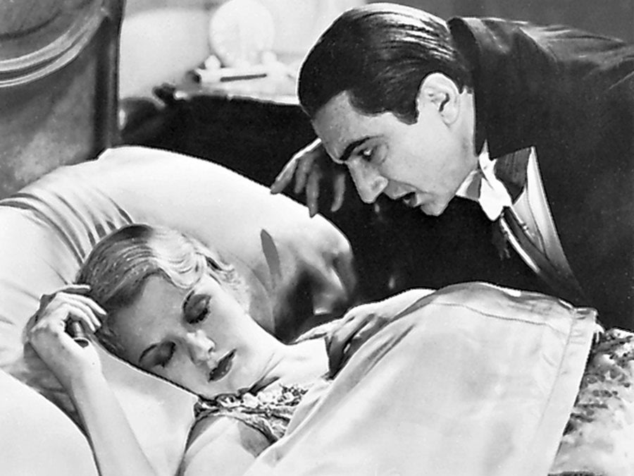Dracula with a sleeping woman.