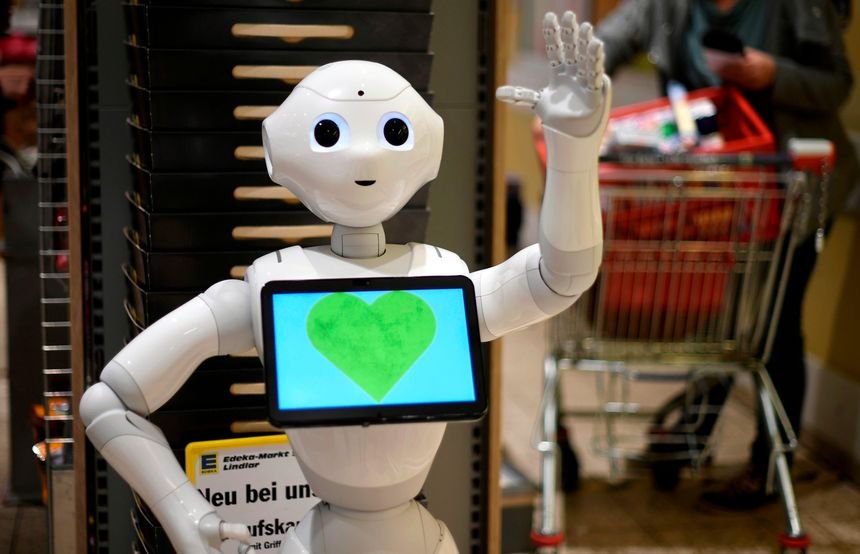 robot with green heart on screen