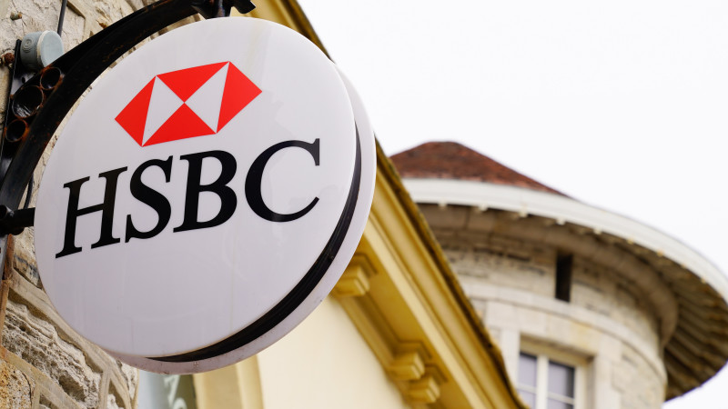 HSBC bank text and red logo swiss round sign store of agency banking of financial services office