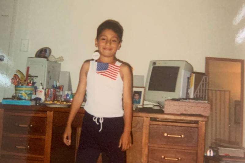 Josue with computer as a child