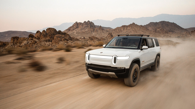Rivian R1S electric vehicle driving in the desert
