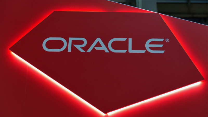 Oracle logo on a red background with lights